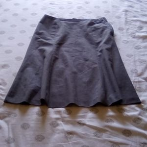 A grey colored skirt.